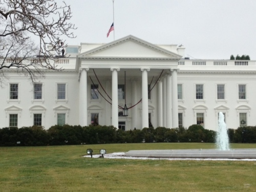 The Stars and Stripes at half-mast over the White House